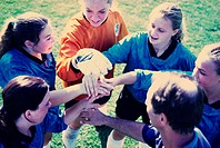 High angle view of a girl´s soccer team in a huddle