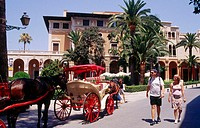 Carriages for tourists in front of Palau March, Palma de Mallorca. Majorca, Balearic Islands. Spain