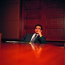 Thinking Arab businessman in a conference room