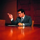 Arab businessman sitting at conference table