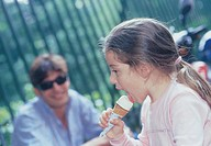 man and little girl eating ice cream
