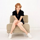 Young woman sitting in a chair