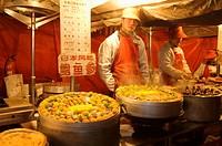 Food vendors at the Donghua Yeshi Night Market. Beijing. China