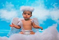 Portrait of a baby girl dressed as an angel