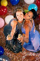 High angle view of two young women holding champagne flutes