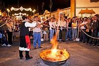 Preparing ´queimada´ (Galician traditional hot alcoholic drink) during folk festival in Fuengirola. Málaga province, Costa del Sol. Andalusia, Spain