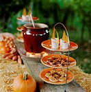 Rustic open-air buffet for a Halloween party