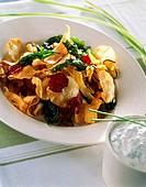 Mixed deep-fried vegetable crisps on a plate