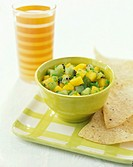 Mango and kiwi fruit salsa with tortilla chips