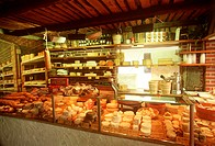 Cheese shop interior with many different cheeses