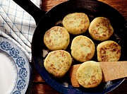 Potato Pancakes in Skillet with wooden Spatula