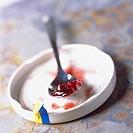 Cranberry jam on spoon
