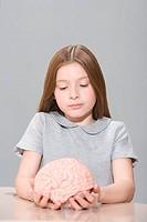 Girl holding a model brain