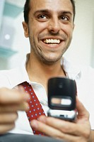 Man using cell phone, smiling