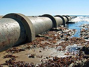 Waste outlet flowing into Ocean and on to beach.
