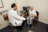 Senior 85 year old female has medical check up with doctor physician