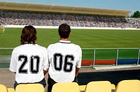 Two soccer friends wearing 2006 on their shirts