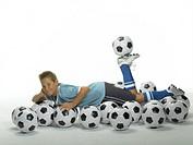 Boy with footballs