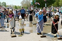 Street washing, a dutch custom in preparation for the Tulip Time parade in Pella, Iowa, USA.