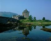 architecture, bridge, Britain, building, calm, canoe, canoeists, canoes, castle, coast, daytime, Dornie, Eilean Dona