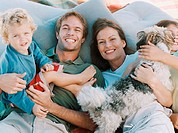Happy family with pet dog