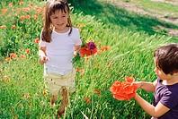 Girls picking wildflowers