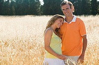 Couple in a field of wheat