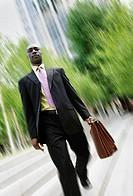 Businessman descending steps
