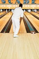 Rear view of man at bowling alley