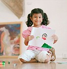 Young girl showing off her drawing