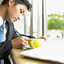 Businessman working at coffee shop