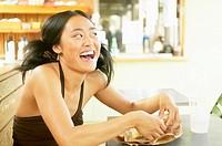 Teenage girl eating sandwich in cafe