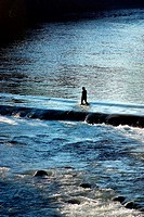 Woman crossing river. Tabasco, Mexico