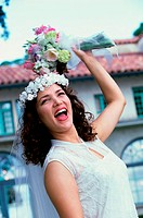 Newlywed young woman preparing to toss the bouquet