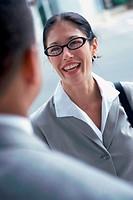 Businessman talking to a businesswoman