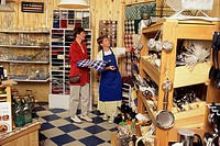 Woman standing in a store with a female store clerk