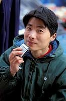 chinese man at porta portese market, rome, italy