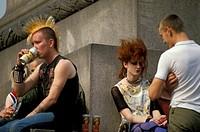 punk people at trafalgar square, london, great britain