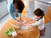 Mother and daughter mixing ingredients