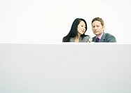 Businessman and businesswoman looking at cell phone