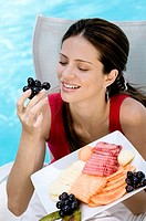 Close-up of a young woman eating fruits