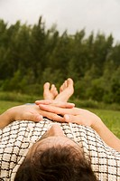 Mid adult man lying on the grass