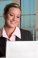 Close-up of a businesswoman in front of a laptop