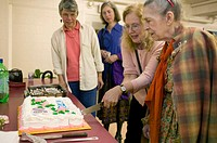 Birthday age 90, Alzheimer´s patient, with care-giver at church basement. Boston. Massachusetts. USA.
