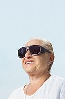 Woman wearing large sunglasses
