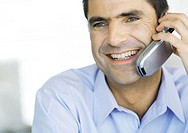 Businessman using cell phone, close-up