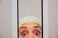 Girl in shower with surprised expression