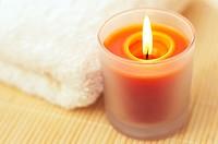 One orange candle burning