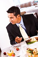 Close-up of a businessman eating