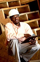 African American construction manager on site